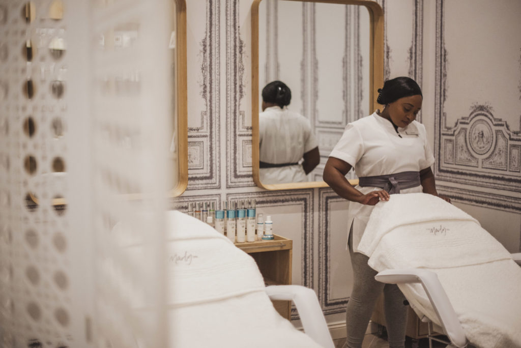 The Marly Spa employee preparing for space for a treatment in Camps Bay, Cape Town